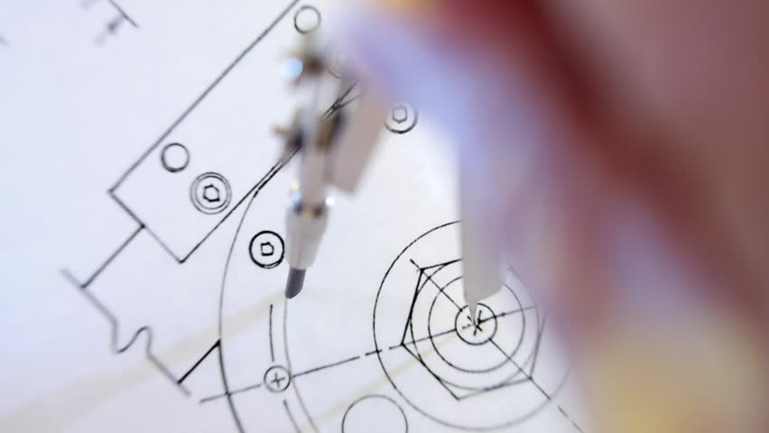 Compasses draws circle on the drawing. The camera is rotating. Closeup. Shallow depth of field