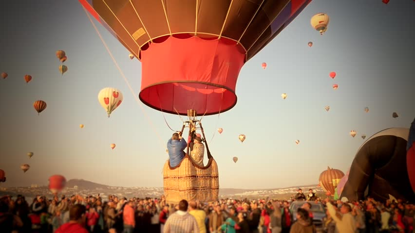 Spectators watching a hot air ballon departing with family in an annual festival | Shutterstock HD Video #10021289