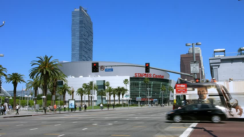 LOS ANGELES, CALIFORNIA, USA - MARCH 26, 2015:  Tourist Bus shows Staples Center to the passengers in LA Downtown Business district on March 26, 2015 in Los Angeles, California, 4K, UHD