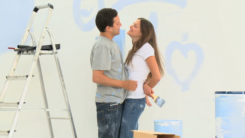 Stock Video Of Young Couple Having Fun While Painting