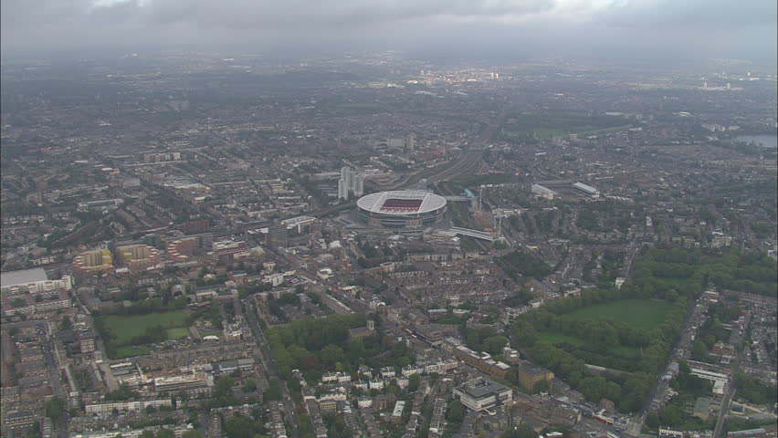 AERIAL United Kingdom-Emirates Stadium 2006: New Arsenal Emirates football Stadium and surrounding area including Finsbury park, zooming in to look onto football pitch within stadium
