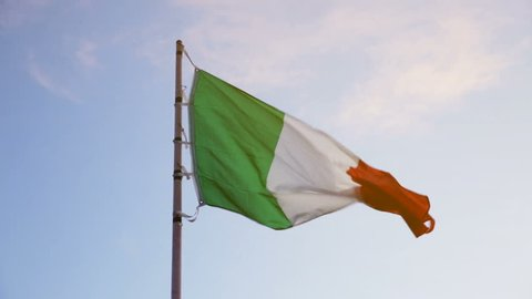 Picture of national tricolour flag of Italy waving against blue sky