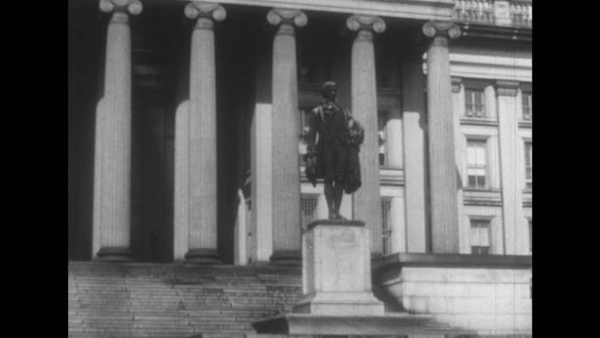 1950s: U.S. Department of Treasury building. Building facade with Roman style columns. Alexander Hamilton statue.