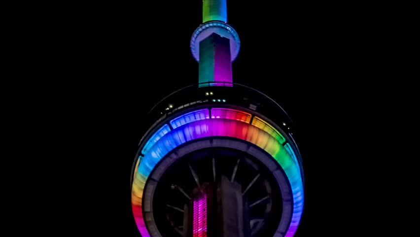 TORONTO, CANADA - AUGUST 24, 2017: Toronto CN Tower (Canadian National, 553m) in multi-colored illumination. CN Tower (completed in 1976) - communications and observation tower in Downtown Toronto.