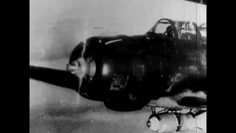 CIRCA - 1941 - Japanese airplanes bomb Pearl Harbor, Hawaii, and retreat on battleships to Japan.