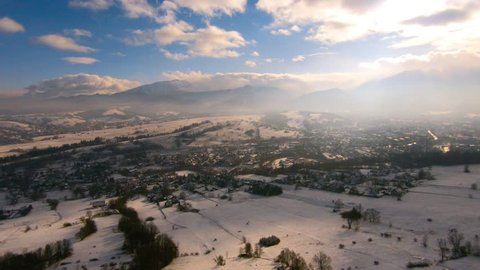 Reveal winter Tatra mountains from a bird's eye view
