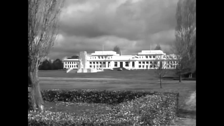 CIRCA 1958 - The Provisional Parliament House, farmland, a neighborhood and church are shown in Australia.