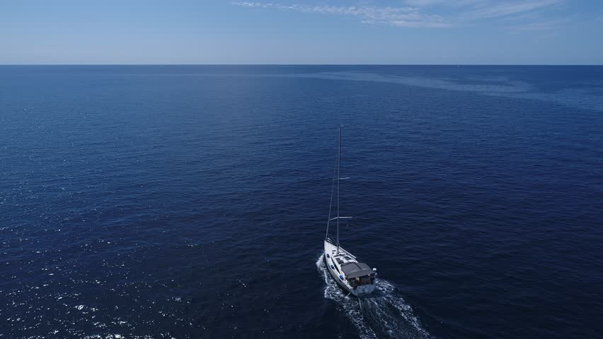 Aerial view of the white yacht running on the blue sea in Montenegro | Shutterstock HD Video #1006710832