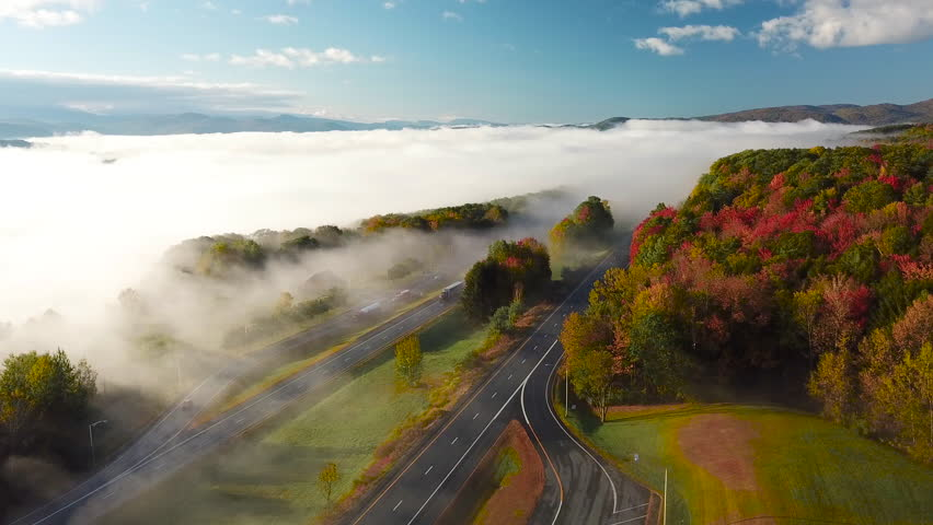 NEW ENGLAND, USA - CIRCA 2010s - Beautiful aerial over a highway through the fog in fall in New England.