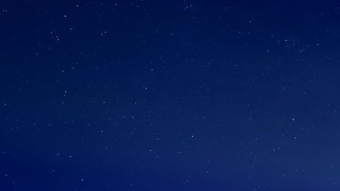 Starry blue night sky, star shine in skies horizon. Time Lapse Beautiful Starry Movement In The Night Sky, Starry night sky with meteor shower Milky Way moving in time lapse. 3840x2160.