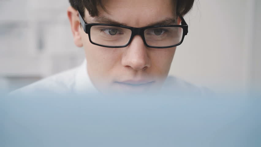Close up view of worried businesman working diligently with computer in office. 4K | Shutterstock HD Video #1006837192