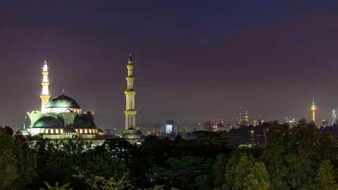 KUALA LUMPUR, MALAYSIA - 18TH JAN 2018; Time lapse of sunrise over Federal Territory Mosque in Kuala Lumpur, the mosque's design is a blend of Ottoman and Malay architectural styles.