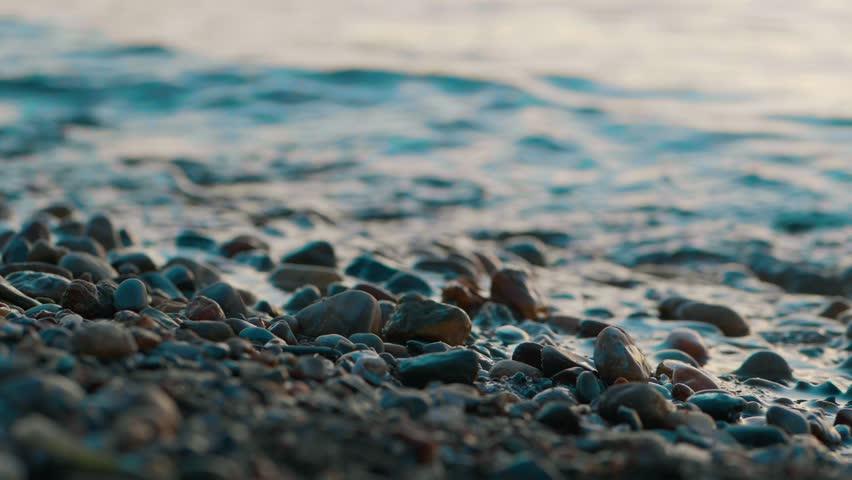 Closeup of a stony beach at evening