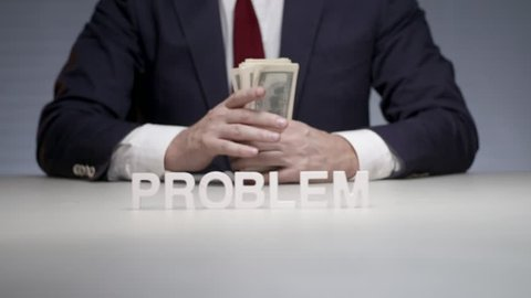 Word problem composed by letters standing on background man with cash bundle