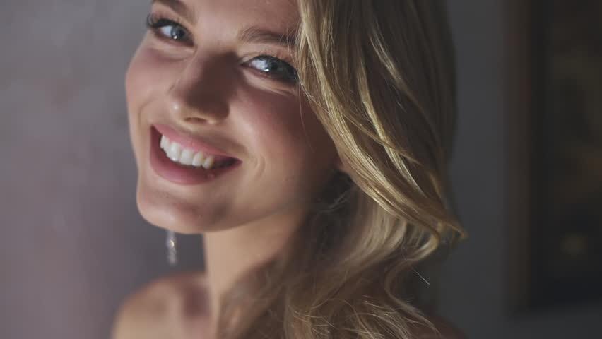 Seductive pretty blond woman   Shutterstock HD Video #1006971022