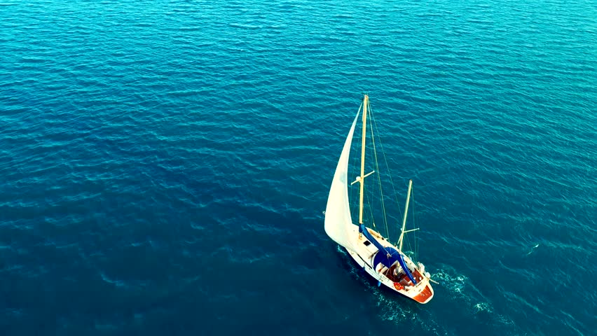 Yacht sailing on opened sea of Seychelles . Sailing boat. Yacht seen from drone. Yachting, aerial 4k cinematic close up
