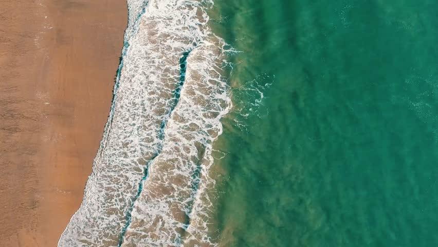 Drone shot of waves California beach