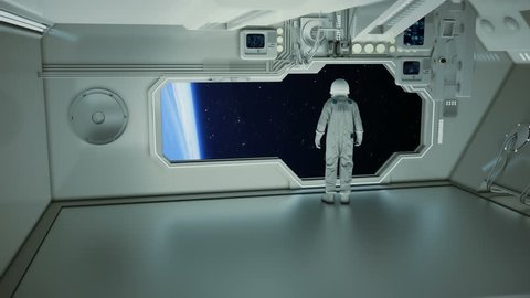 An astronaut on a spaceship watching the earth