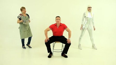 Funny dance, humor. Strange freak show dancing:funny  man, senior woman with saucepan and pretty blonde robot