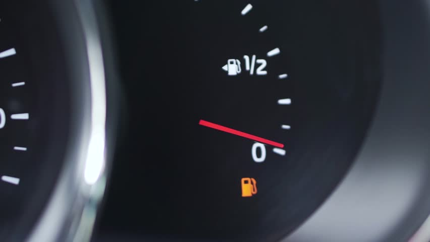 Close-up car dash board petrol meter, fuel gauge, with over full gasoline in car. Clip. Gasoline sensor