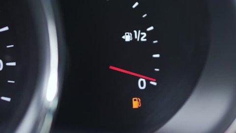 Close-up car dash board petrol meter, fuel gauge, with over full gasoline in car. Clip. Gasoline sensor