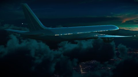 Commercial jet airplane flying above the night clouds in moonlight