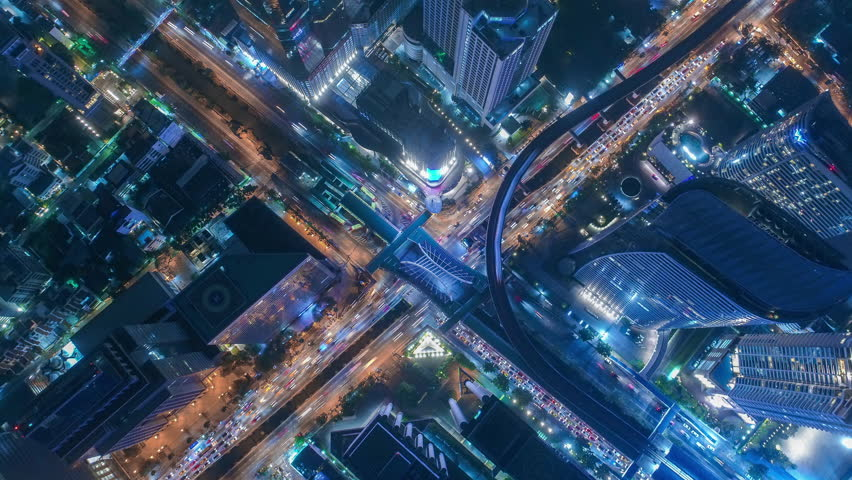 Time lapse,Hyper lapse , Of traffic on city streets in Thailand. Aerial view and top view Expressway with car lots. | Shutterstock HD Video #1007138872