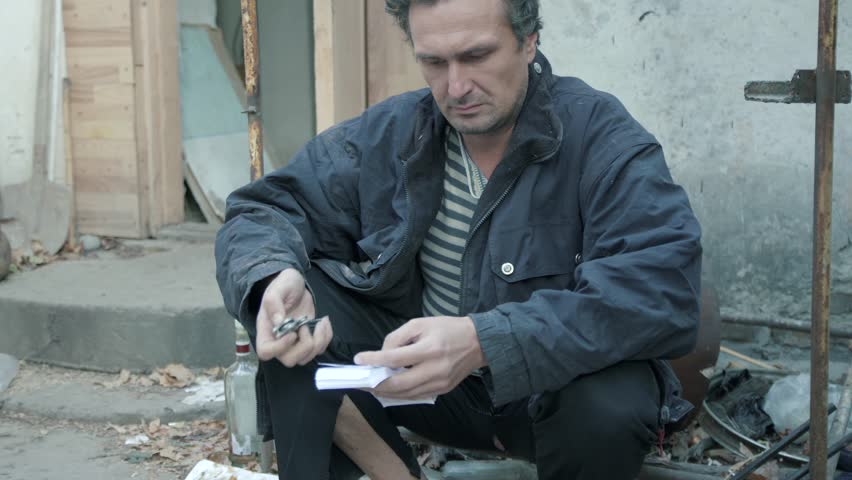 A man holding a knife and money. Preparing the attempt on the life of. Doubt and conscience 4K