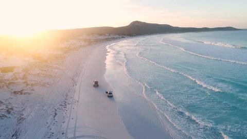 Driving along sand in secluded, isolated and untouched beach in Western australia