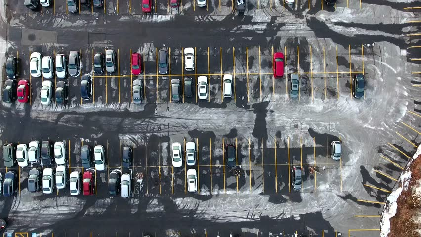 Top down aerial vertical view of car parking. Flying over parking in a daylight.    | Shutterstock HD Video #1007158522