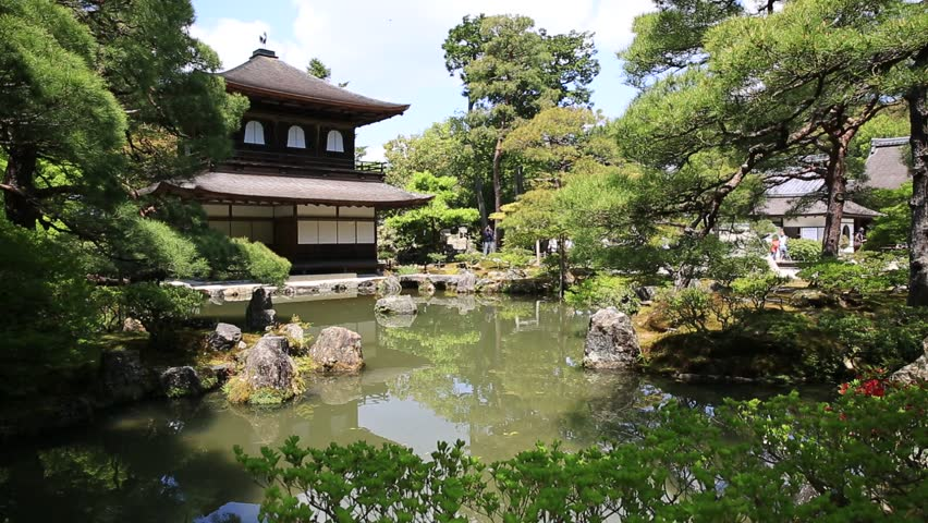 Scenic landscape of pond in springtime and architecture of Kannon-Hall in Ginkakuji Temple. Ginkaku-ji or Silver Pavilion, officially Jisho-ji, is a Zen temple in Higashiyama District, Kyoto, Japan.
