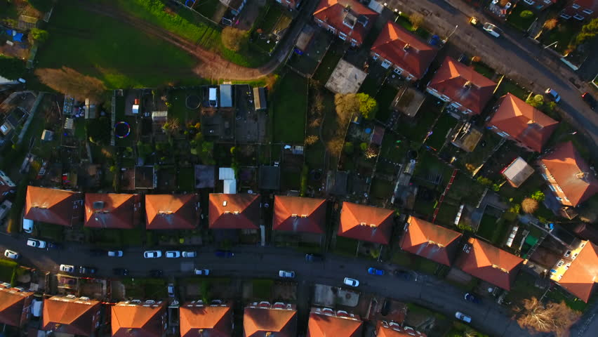 Aerial drone shot of British housing council estate in the UK, English house and homes from above, semi detached  | Shutterstock HD Video #1007160472