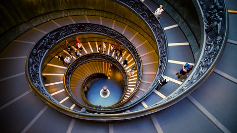 Vatican City, Vatican - Oct 6, 2017: People on Bramante Staircase in Vatican Museums in the Vatican City, Rome, Italy . The helix staircase is the travel destination of The Vaticans and Rome, Italy.