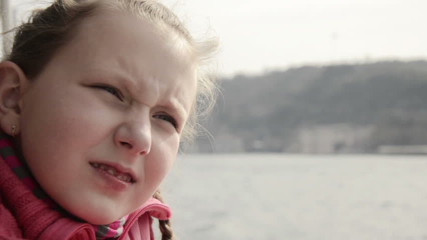 Facial expressions: Beautiful, cute, happy, girl, child, blonde, blue eye,  long hair, on boat trip, travel, enjoy, lean on banister of ship, looking  to sea, ...