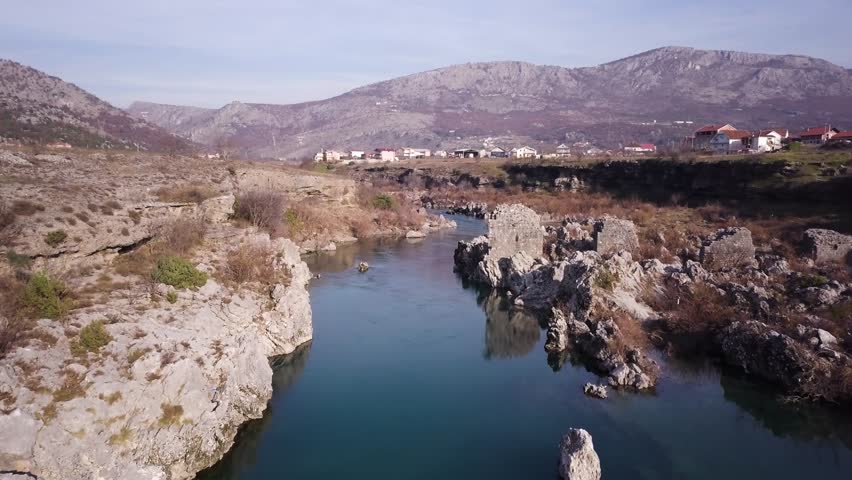 Fallen Roman Aqueduct in Mora?a canyon. Near 1st century city of Doklea (Doclea) Duklja. River Mora?a Podgorica  Montenegro. Historical site. Archaeological site