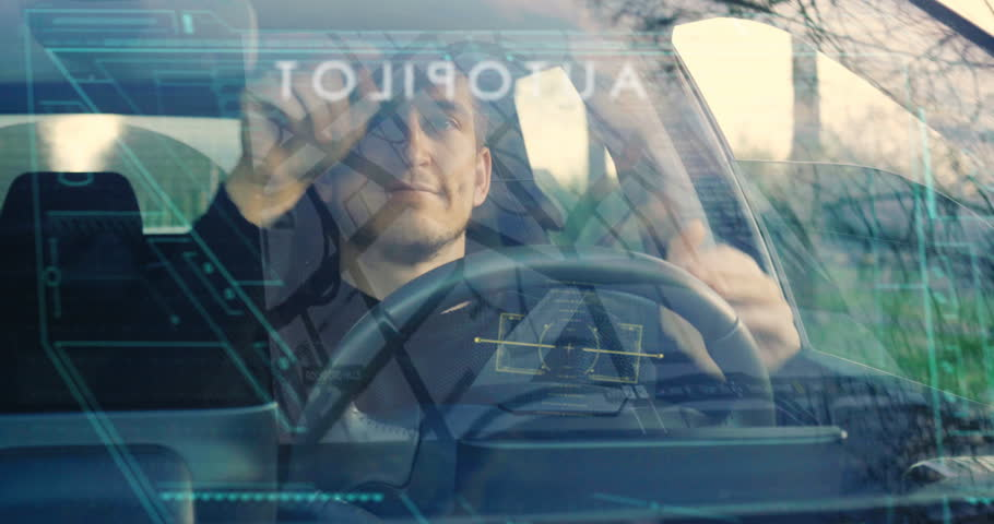 A man drives his futuristic car and when he activates the autopilot the car drives itself and can relax. Concept of: Technology, holography, future, transport and cars. | Shutterstock HD Video #1007264062