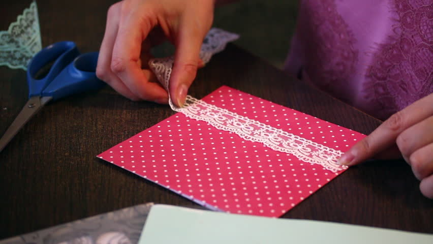 The girl is engaged in stock footage video 100 royalty free hd0011the girl is engaged in making greeting cards at home using paper lace braid and other materials m4hsunfo