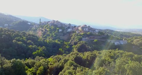 AERIAL: Cinematic view over Venzolasca village in Corsica, France.