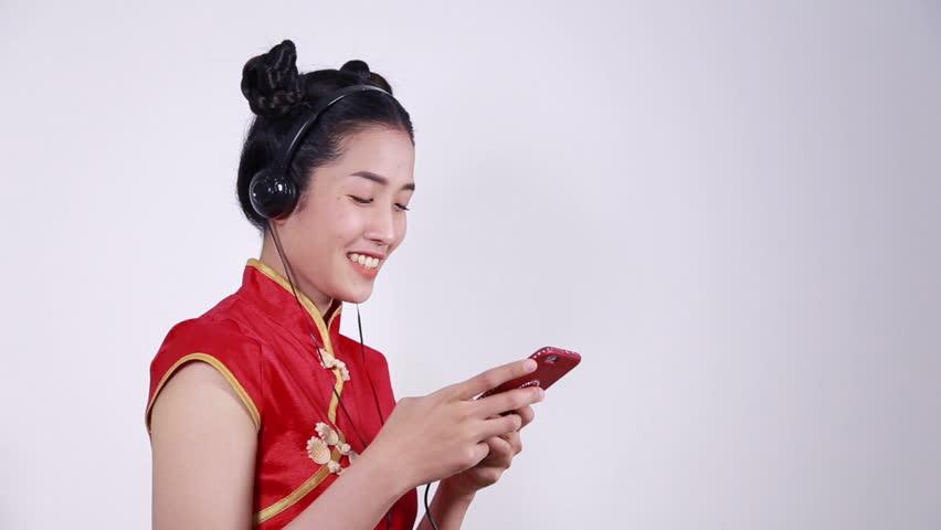 happy woman wear cheongsam and using mobile phone
