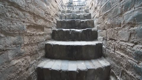 POV view of a person walking up the stairs of an old castle