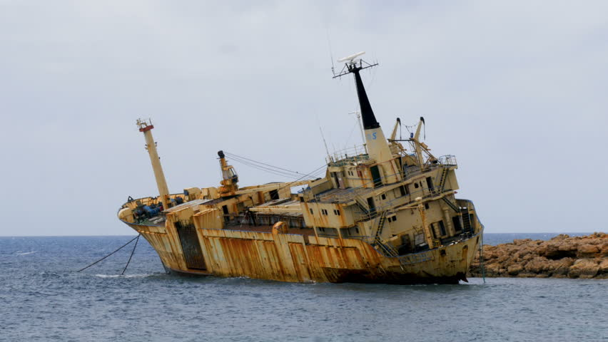 The old ship ran aground, shipwreck off the coast, abandoned ship, off the coast of Cyprus. Ecological disaster.