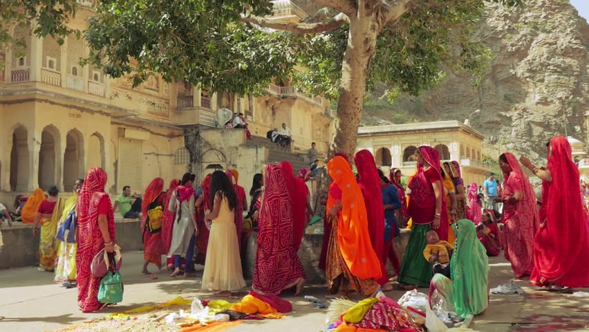 JAIPUR, INDIA - October 2017 :Slow motion dolly shot. Hindu people at Galtaji temple, Jaipur, Rajasthan, India.
