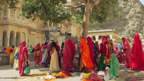 JAIPUR, INDIA - October 2017: Hindu people at Galtaji temple, Jaipur, Rajasthan, India. Slow motion dolly shot.