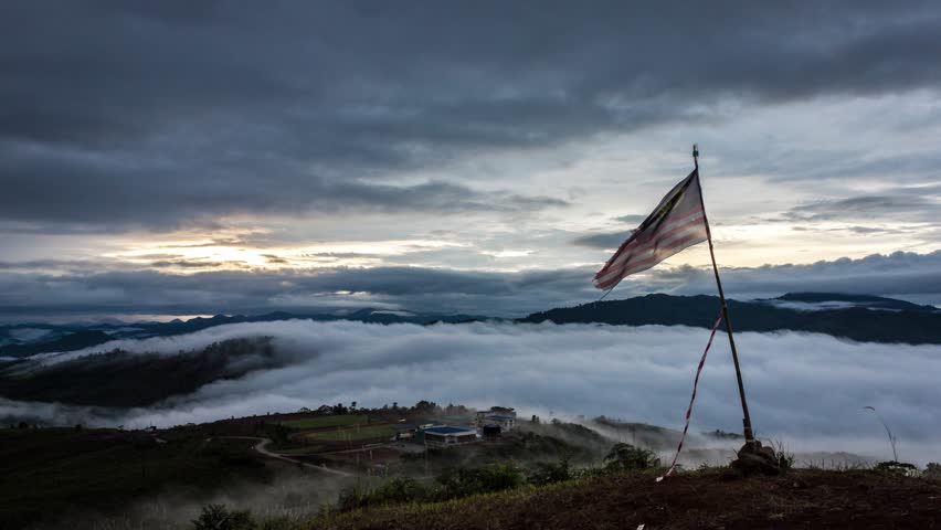 4k time lapse footage Malaysia flag and drifting misty. Taken at Ranau Paragliding park,Sabah,Borneo | Shutterstock HD Video #1007374582