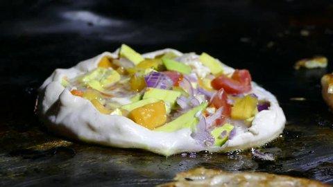 zanzibar pizza on a frying pan in forodhani garden
