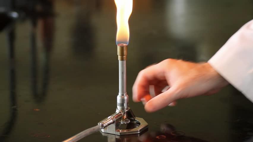 stock video of adjusting the bunsen burner