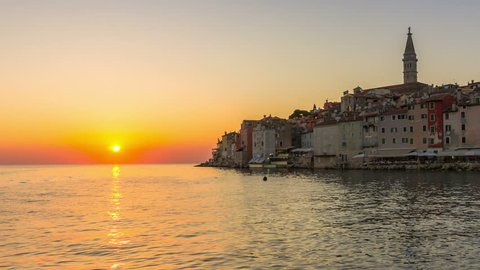 Sunset time lapse at Rovinj, Croatia - Panoramic view of old town of Rovinj in Istria, Croatia at beautiful colorful sunset sky. Rovinj is popular tourist resort, fishing port and culture of Croatia.