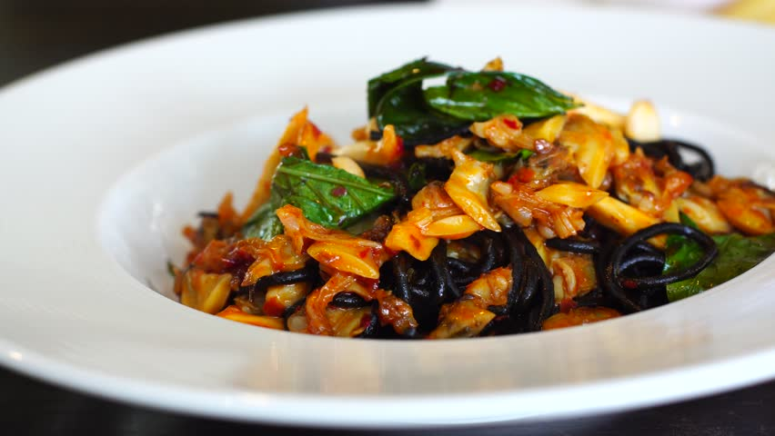 Black Spicy spaghetti with seafood and basil. | Shutterstock HD Video #1007478622