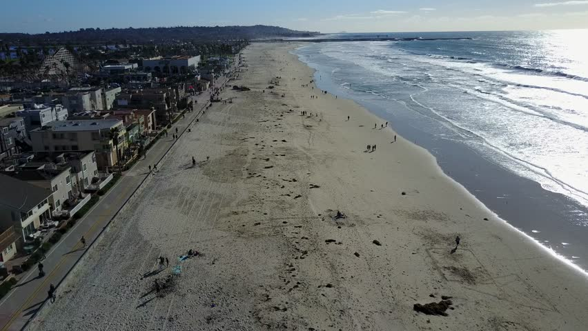 San Diego - Mission Beach - Drone Video. Aerial Video of historic oceanfront park located in the Mission Bay area of San Diego, California. The park was developed on July 4, 1925.