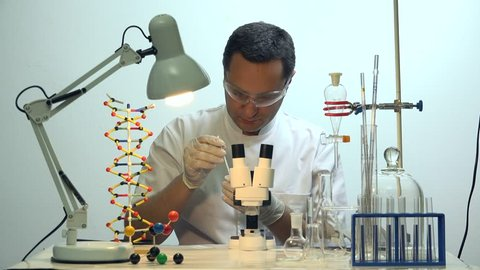 Man making a test in chemistry laboratory, science development